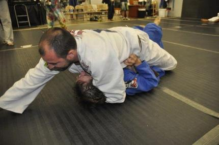 My instructor, mounted on me, in the longest minute of my BJJ life.