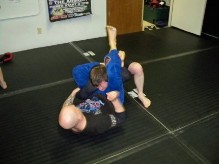 Getting triangled as a no-stripe white belt.